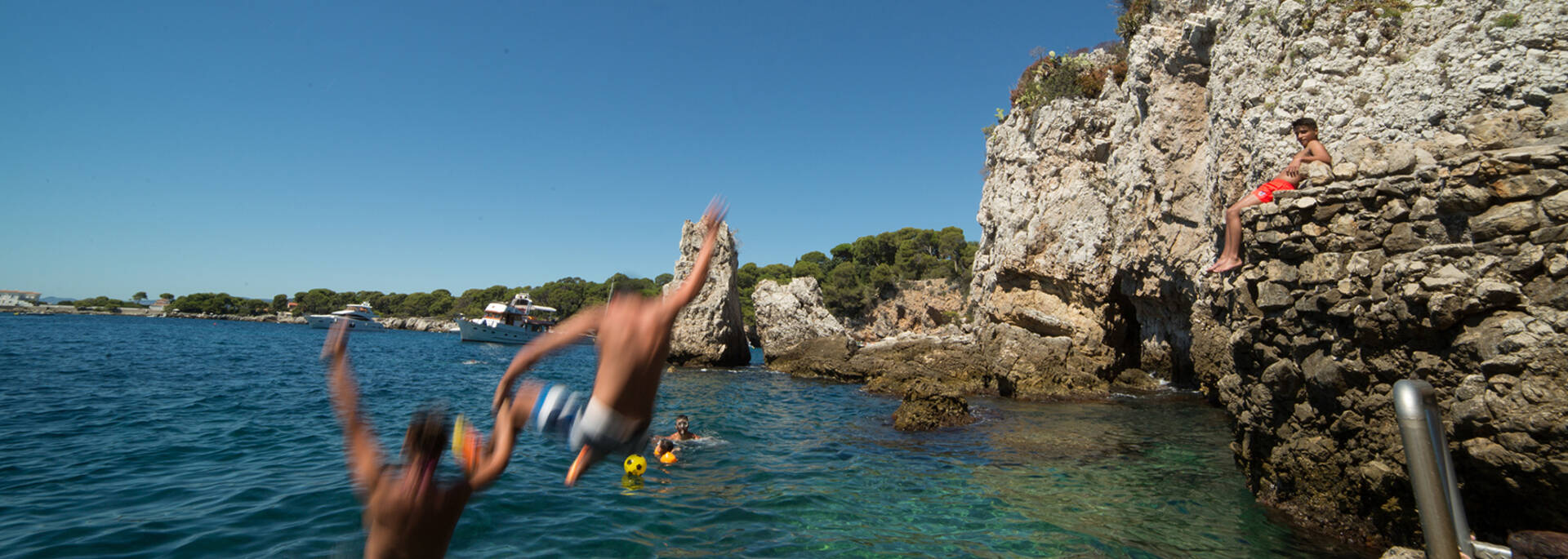 During the summer, people dive from the rocks